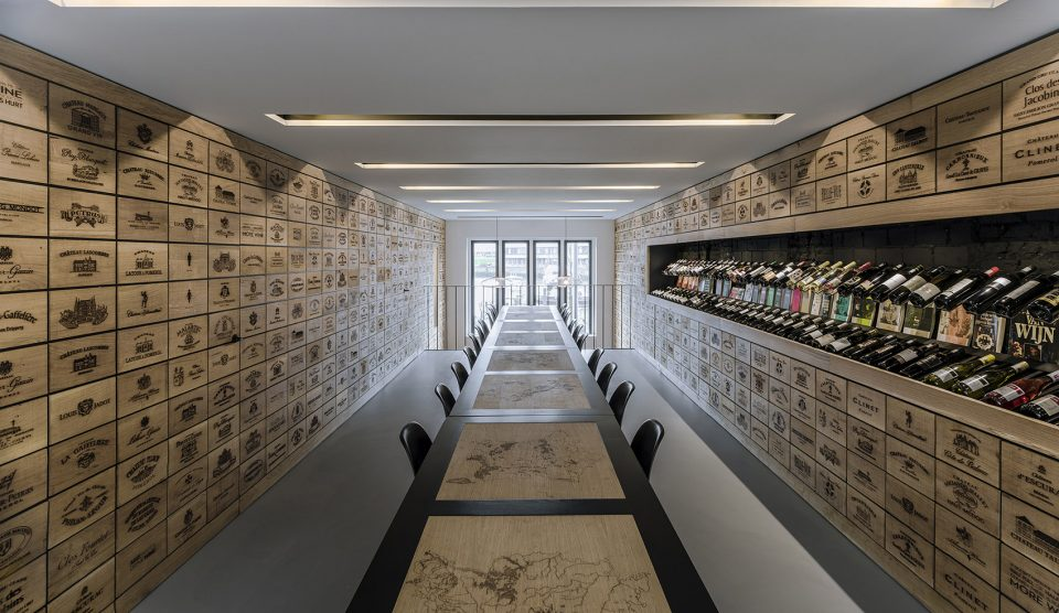 008-Wineshop-Clad-with-2100-Engraved-Oak-Panels-960x556